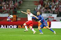 8th September 2021; PGE National Stadium, Warsaw, Poland: FIFA World Cup 2022 Football qualification, Poland versus England;  KAMIL JOZWIAK clashes with LUKE SHAW