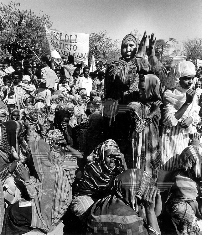 ©Hamish Wilson/Panos Pictures..Somaliland. Women demostrating for peace. The banner reads There is no life without peace of milk (milk is a pastoralists symbol for peace and prosperity).