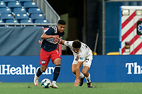 FOXBOROUGH, MA - JULY 23: Damian Rivera #72 of New England Revolution II dribbles as Jon-Talen Maples #34 of Toronto FC II defends during a game between Toronto FC II and New England Revolution II at Gillette Stadium on July 23, 2021 in Foxborough, Massachusetts.