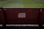 A sign on the perimeter fence of the ground before Ilkeston Town host Walsall Wood in a Midland Football League premier division match at the New Manor Ground, Ilkeston. The home team were formed in 2017 taking the place of Ilkeston FC which had been wound up earlier that year. Watched by a crowd of 1587, their highest of the season, the match was top versus second, however, the visitors won 4-0 and replaced their hosts at the top of the division on goal difference with two matches to play