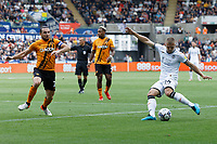 Jake Bidwell of Swansea City (R) takes a cross during the Sky Bet Championship match between Swansea City and Hull City at the Swansea.com Stadium, Swansea, Wales, UK. Saturday 11 September 2021