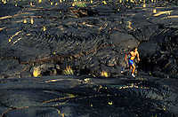 Man - getting a workout running on the lava fields on the Big Island