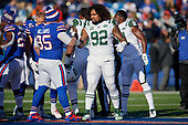 New York Jets Leonard Williams (92) shakes hands with Kyle Williams (95) before the coin flip during an NFL football game against the Buffalo Bills, Sunday, December 9, 2018, in Orchard Park, N.Y.  (Mike Janes Photography)