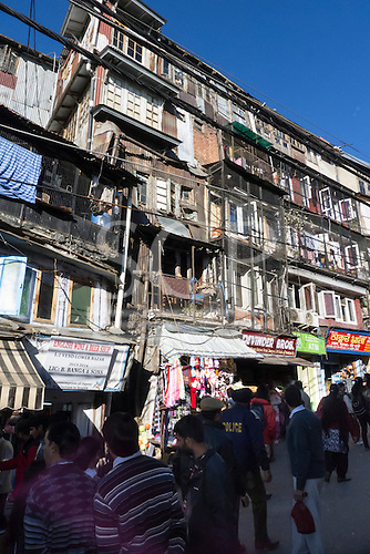Shimla, Himachal Pradesh, India. Densely populated ramshackle town centre buildings with shops at street level and residential accommodation above on Lower Bazaar.