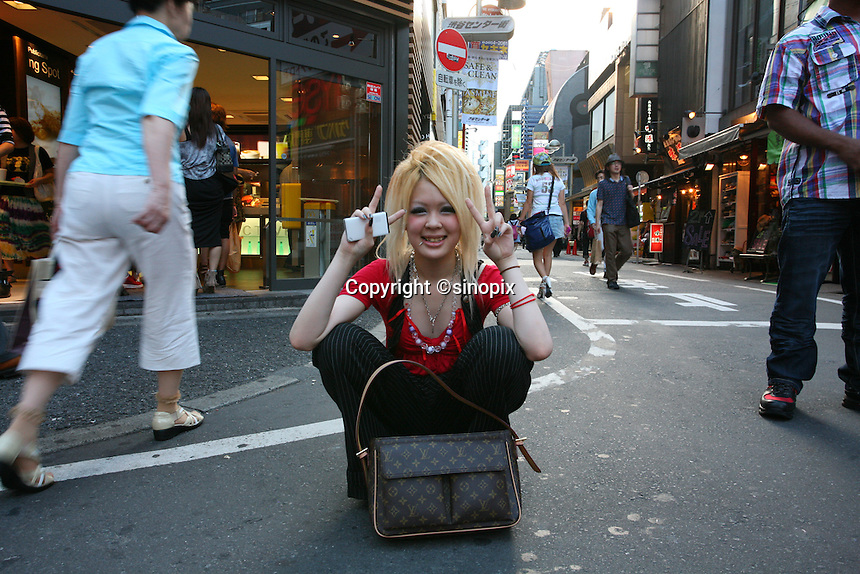 Ms. Asuka Haneda, 18 years old, is hanging out on the street in Shibuya District of Tokyo, where a lot of Japanese young generations hang out.  The picture was taken on July 16, 2010 by Masataka Namazu (http://www.masatakanamazu.com +81. 80. 5042. 3536).