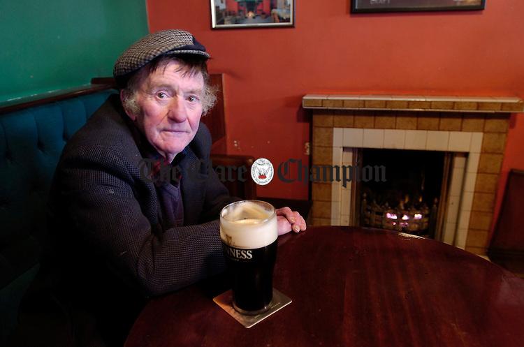 Kilrush Man Ger Daly enjoying his usual stuff in O Briens of Kilrush. Photograph by John Kelly.