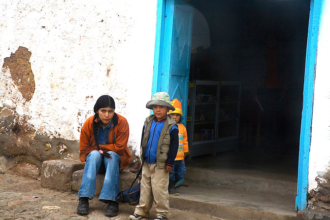 A MOTHER AND TWO CHILDREN OUTSIDE STORE AT MOLLEPATE,PERU