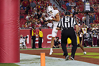 LOS ANGELES, CA - SEPTEMBER 11: Brycen Tremayne #81 of the Stanford Cardinal catches a touchdown pass during a game between University of Southern California and Stanford Football at Los Angeles Memorial Coliseum on September 11, 2021 in Los Angeles, California.