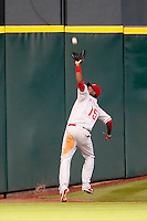 Philadelphia Phillies outfielder John Mayberry Jr #15 makes a running catch during the Major League Baseball game against the Houston Astros at Minute Maid Park in Houston, Texas on September 13, 2011. Houston defeated Philadelphia 5-2.  (Andrew Woolley/Four Seam Images)