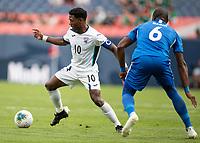 DENVER, CO - JUNE 19: Aricheell Hernandez #10 tries to maneuver around Jean-Sylvain Babin #6 during a game between Martinique and Cuba at Broncos Stadium on June 19, 2019 in Denver, Colorado.