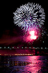 Fireworks over the Jacques Cartier bridge and the St. Laurent River in Montreal, Quebec, Canada.