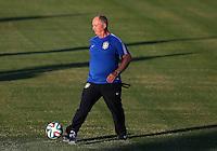 Brazil head coach Luiz Felipe Scolari controls the ball during training ahead of tomorrow's World Cup quarter final vs Colombia tomorrow