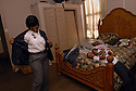 Anisha Washington gets ready for work while Gerald Burton, Jequaa Burton and Jessica Burton take a nap, New Orleans, Wednesday, Dec. 19, 2007...(AP Photo/Cheryl Gerber)