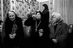 """Woman drinking Holy water from well outside of house. Mrs Nora Arthurs, a Catholic Voice-Box, Seer and Mystic, in her home know as<br /> 'Mary's House"""", on Canvey Island, Essex UK conducting a prayer meeting. 1996"""