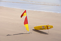 Lifeguard equipment and flag, Filey, North Yorkshire.