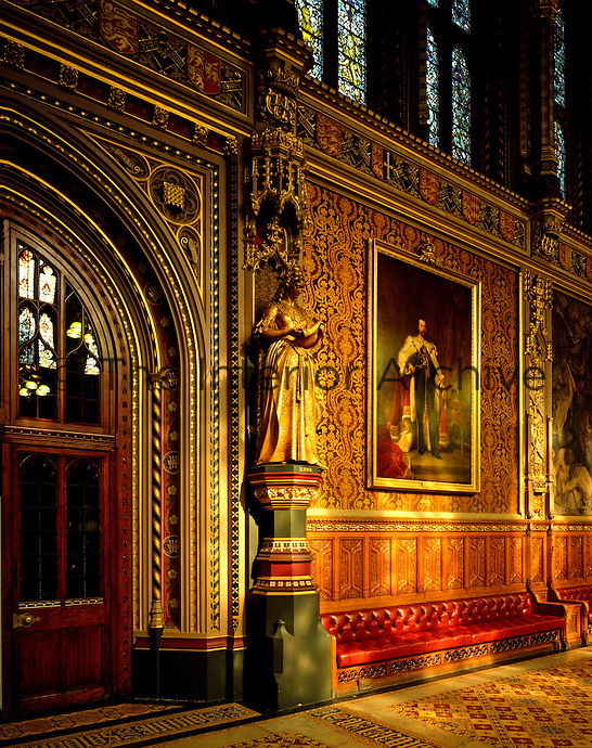 A coronation portrait of King George V, by Luke Fildes, hangs beside another past monarch, Queen Anne, in the opulent surroundings of the Royal Gallery