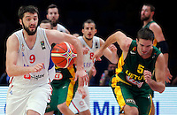 Serbia's Stefan Markovic (L) vies with Lithuania's Mantas Kalnietis (L) during European championship semi-final basketball match between Serbia and Lithuania on September 18, 2015 in Lille, France  (credit image & photo: Pedja Milosavljevic / STARSPORT)