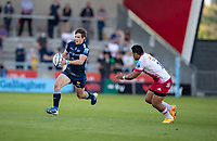 4th June 2021; AJ Bell Stadium, Salford, Lancashire, England; English Premiership Rugby, Sale Sharks versus Harlequins;  AJ MacGinty of Sale Sharks tracked by  Ben Tapuai of Harlequins