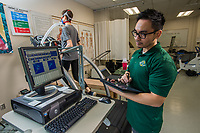 Human Performance Testing Adjunct Junland Navarro monitors Physical Education Major and Seawolf Track and Field Athlete Yvonne Jeschke during testing in the Human Performance Lab in UAA's Eugene Short Hall.