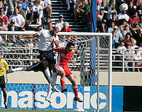 Oguchi Onyewu leaps to head the ball. USA defeated China, 4-1, at Spartan Stadium in San Jose, Calif., on June 2, 2007.