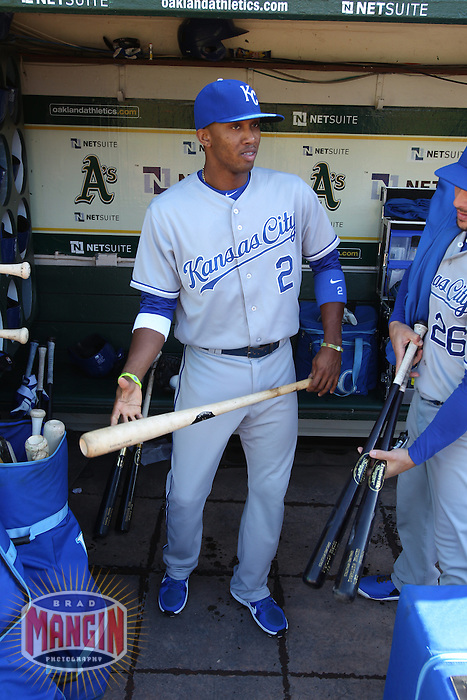 OAKLAND, CA - MAY 18:  Alcides Escobar #2 of the Kansas City Royals gets ready in the dugout before the game against the Oakland Athletics at O.co Coliseum on Saturday May 18, 2013 in Oakland, California. Photo by Brad Mangin
