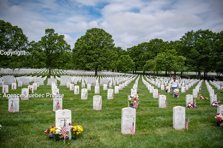 Family members visit gravesites of their loved ones on Memorial Day in Section 60 of Arlington National Cemetery, Arlington, Virginia, May 25, 2020. (U.S. Army photo by Elizabeth Fraser / Arlington National Cemetery / released)