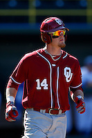 Matt Oberste #14 of the Oklahoma Sooners runs to first base during a game against the UCLA Bruins at Jackie Robinson Stadium on March 9, 2013 in Los Angeles, California. (Larry Goren/Four Seam Images)