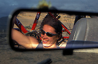 Helen Mortimer sitting in back of 4x4 with bike, reflection in mirror . Fuerteventura , Canary Islands,  1999. .pic copyright Steve Behr / Stockfile