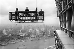 The Peoples Republic of China. Shanghai. 2000. Window cleaners get a lift to the top of the Jin Mao Building in Pudong.  The elevated highway of Yan An Zhong Lu can be seen snaking down to the Bund, while the dark area to the left is the site of old Chinese city known as Nanshi.