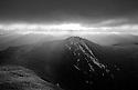 Sunlight spills over Mt. Flume, shortly after sunrise on a cold november morning.