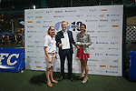 Lisa Foley (left) gives his reward to the winner of the Fiji Airways lucky draw during GFI HKFC Rugby Tens 2016 on 07 April 2016 at Hong Kong Football Club in Hong Kong, China. Photo by Juan Manuel Serrano / Power Sport Images