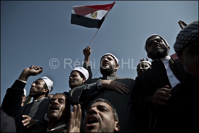 """© Remi OCHLIK/IP3 - Cairo Feb. 01 -- Tahrir square - Men from muslim brotherhood organization protest during the Egypt's """"million man march"""".. Whether they achieved that targeted head count is unclear, but their message was unequivocal.""""Mubarak get out!"""" protesters chanted. Tuesday's rally in downtown Cairo was the largest anti-government demonstration in modern Egyptian history, drawing the full spectrum of Egyptian society. Wave after wave of men, women and children poured into the central square from morning until well after the government's 3pm curfew...It was the eighth consecutive day of protests calling for Egyptian President Hosni Mubarak to step down. Earlier this week the 83-year-old dictator, who has ruled Egypt for 30 years, appointed a vice-president and changed his cabinet to appease the public's growing anger. Protesters say he has missed the point entirely."""
