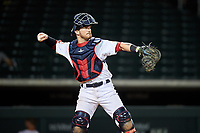 Mesa Solar Sox catcher Gavin Collins (12), of the Cleveland Indians organization, during an Arizona Fall League game against the Peoria Javelinas on September 21, 2019 at Sloan Park in Mesa, Arizona. Mesa defeated Peoria 4-1. (Zachary Lucy/Four Seam Images)