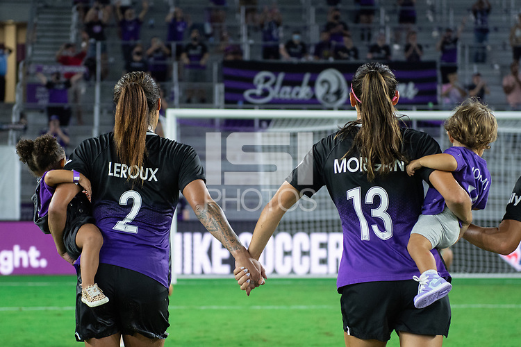 ORLANDO, FL - SEPTEMBER 11: Sydney Leroux #2 and Alex Morgan #13 of the Orlando Pride celebrate a victory during a game between Racing Louisville FC and Orlando Pride at Exploria Stadium on September 11, 2021 in Orlando, Florida.
