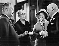 Jean Lesage (G) Lors de la Visite de la Reine Elizabeth II les 10 et 11 Octobre 1964, a Québec<br /> <br /> <br /> Quebec premier Jean Lesage, left, has informal chat over tea with Ontario Lt.-Gov. Earl Rowe at Queen's Park yesterday. Next to Mr. Lesage are Mrs. Rowe and Mrs. Lesage. The premier is on a three-day goodwill visit to Toronto. Earlier he told the Ontario Legislature that in spite of noisy statements that have been widely publicized, Quebec doesn't want to adopt an I-want-to-be-alone attitude.<br /> <br /> 1964<br /> <br /> PHOTO :  Frank Grant - Toronto Star Archives - AQP