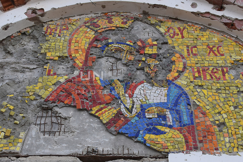 Mosaic piece over the entrance to an orthodox church after shelling near Donetsk International Airport, 18 May 2015