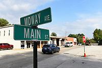 Traffic moves Wednesday Oct. 6 2021 along Arkansas 112 through downtown Cave Springs.<br />(NWA Democrat-Gazette/Flip Putthoff)