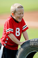 August 2, 2009:  Muckdogs on field promotions during a game at Dwyer Stadium in Batavia, NY.  The Muckdogs are the Short-Season Class-A affiliate of the St. Louis Cardinals.  Photo By Mike Janes/Four Seam Images