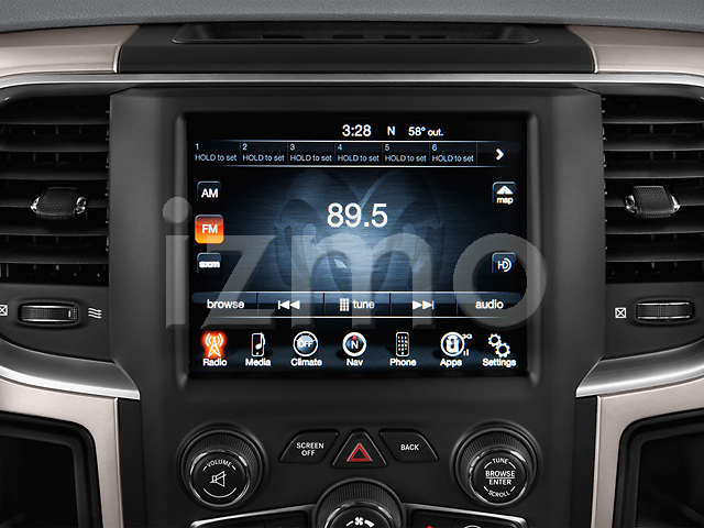 Stereo audio system close up detail view of a 2013 Dodge RAM 1500 Big Horn Crew Cab