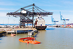 Loading containerized intermodal freight at the Port of Tacoma.   Commencement Bay's history of industry and shipping has led it to designation as a Superfund Cleanup Site and one of the most polluted waterways in the nation.  Commencement Bay Nearshore/Tideflats (CB/NT) Superfund Site.
