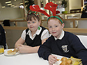 16/12/2010   Copyright  Pic : James Stewart.028_carol_singers  .::  SERCO :: PUPILS FROM LARBERT VILLAGE PRIMARY SCHOOL BUILD UP THEIR ENERGY BEFORE THEY SING CAROLS FOR THE STAFF AND VISITORS AT THE FORTH VALLEY ROYAL HOSPITAL RESTAURANT   ::