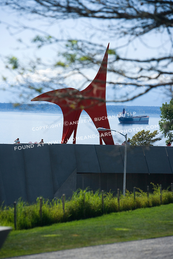 """Perhaps the most iconic of Olympic Sculpture Park's pieces is Alexander Calder's, """"Eagle, 1971"""", seen here from near the main Paccar Pavilion and looking west toward Puget Sound and the Olympic Mtns. beyond.   SAM's Olympic Sculpture Park, Seattle, WA."""