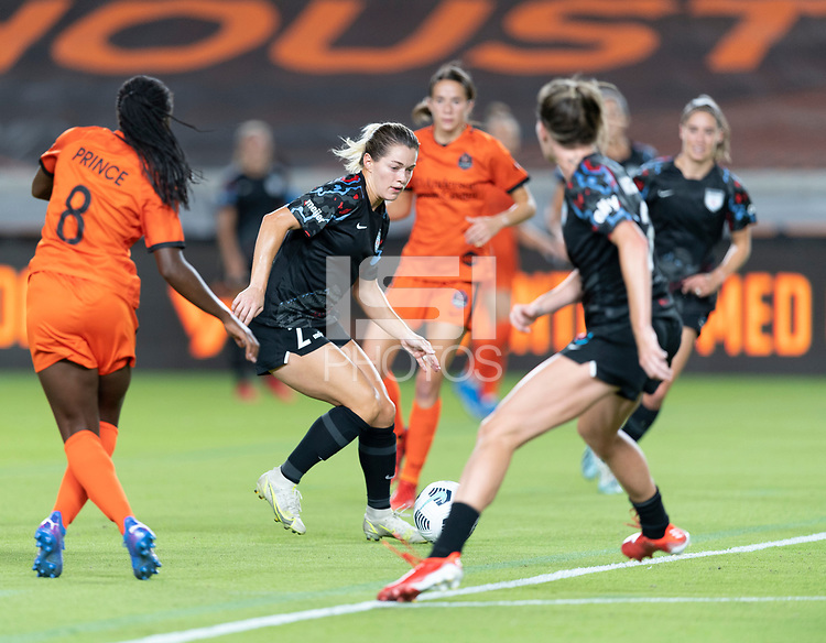 HOUSTON, TX - SEPTEMBER 10: Kealia Watt #2 of the Chicago Red Stars attempts to dribble the ball out of a crowd during a game between Chicago Red Stars and Houston Dash at BBVA Stadium on September 10, 2021 in Houston, Texas.