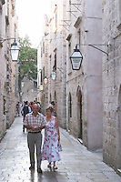 The narrow Od Puca shopping street with tourists and old buildings, a couple walking Dubrovnik, old city. Dalmatian Coast, Croatia, Europe.