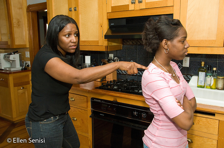 MR / Schenectady, New York.Teenaged daughter (17, African American) turns back to Mother (40, African American) during argument..MR: Law5 Wil33.© Ellen B. Senisi