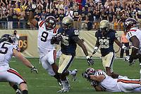 Pitt safety Jason Hendricks (20) returns an interception as Virginia Tech tight end Randall Dunn (9) tries to make a tackle. The Pitt Panthers defeated the Virginia Tech Hokies 35-17 at Heinz field in Pittsburgh, PA on September 15, 2012.