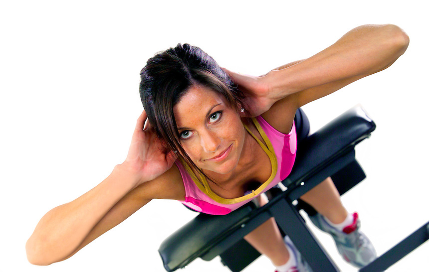 Beautiful female in her work out on a machine doing a workout