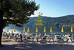 Oesterreich, Kaernten, Millstaetter See, Millstatt: Hotel Seewirt, Cafe mit Seeterrasse | Austria, Carinthia, Lake Millstatt, Millstatt: cafe with seaside terrace, Hotel Seewirt