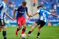 12th September 2021: Barcelona, Spain:  Antoine Griezmann of Atletico de Madrid tackled by Manuel Morlanes during the Liga match between RCD Espanyol and Atletico de Madrid at RCDE Stadium in Cornella, Spain.