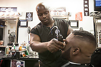 HSUL 20140818 United States, Ferguson, MO. Toriano Johnson cuts Tony Henley's hair in in a barbershop on West Florissant Avenue in Ferguson, Missouri, on August 18, 2014. Photographer: David Brabyn